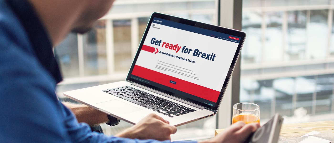 A man looking at the Get ready for Brexit website on a laptop.