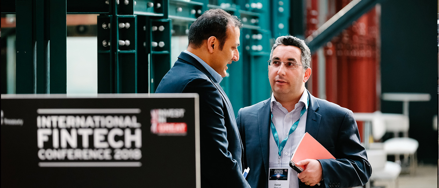 Two male delegates, having a discussion at the UK Government International FinTech Conference