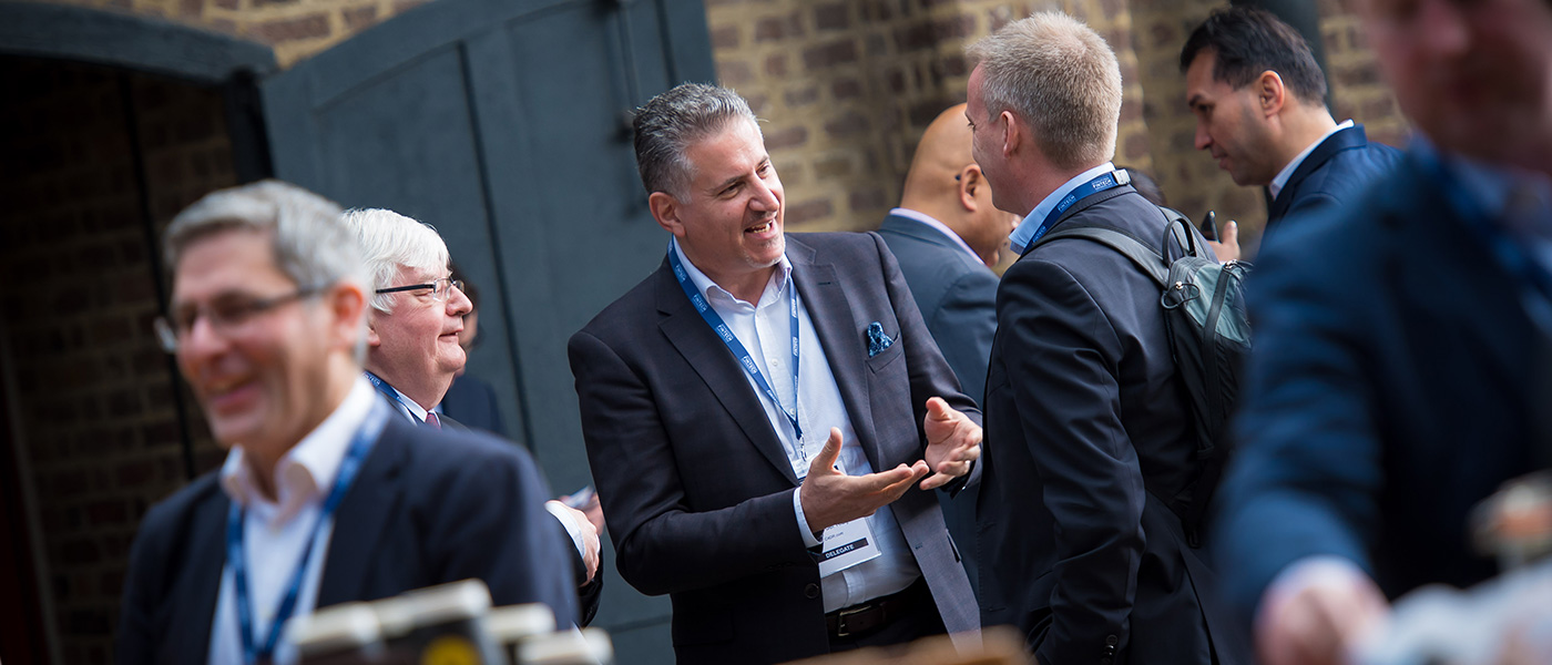 Male delegates enjoying a conversation whilst networking at the UK Government International FinTech Conference.