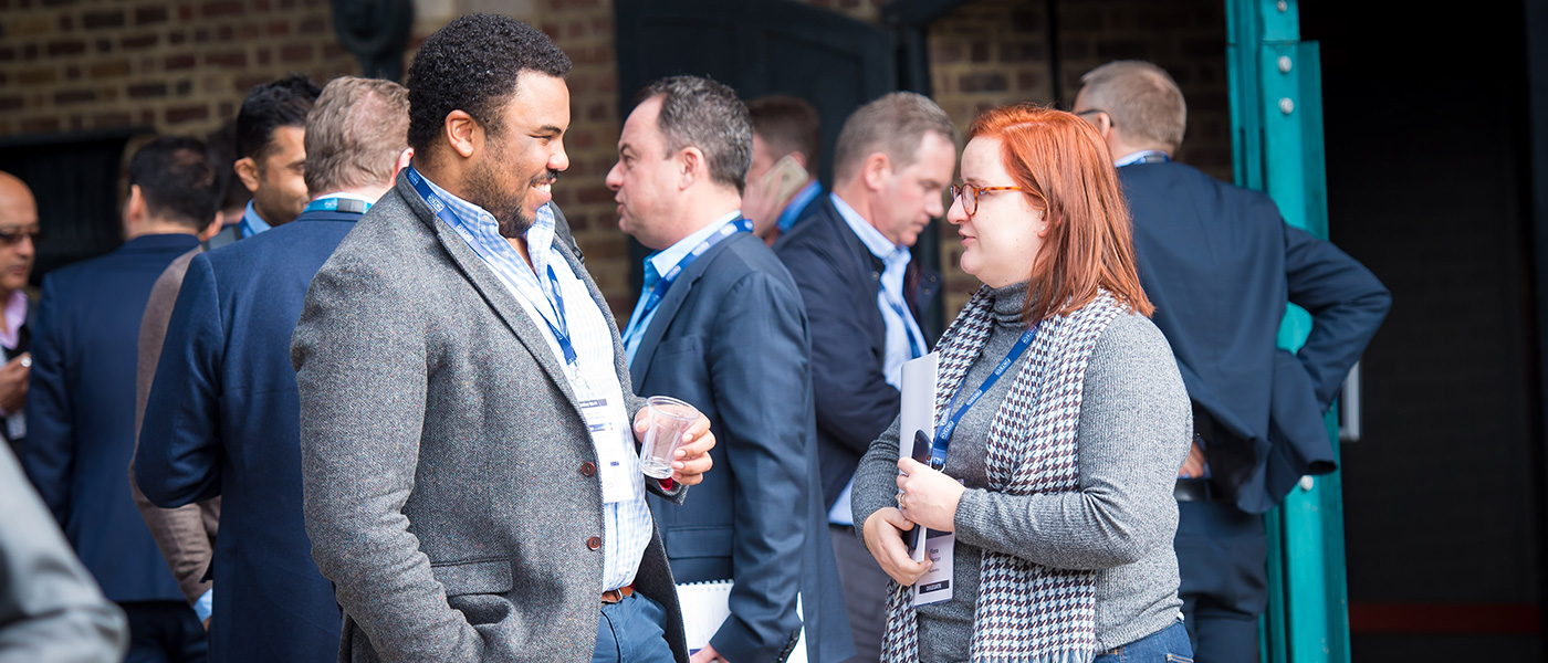 A male and female delegate enjoying a discussion at the UK Government International FinTech Conference