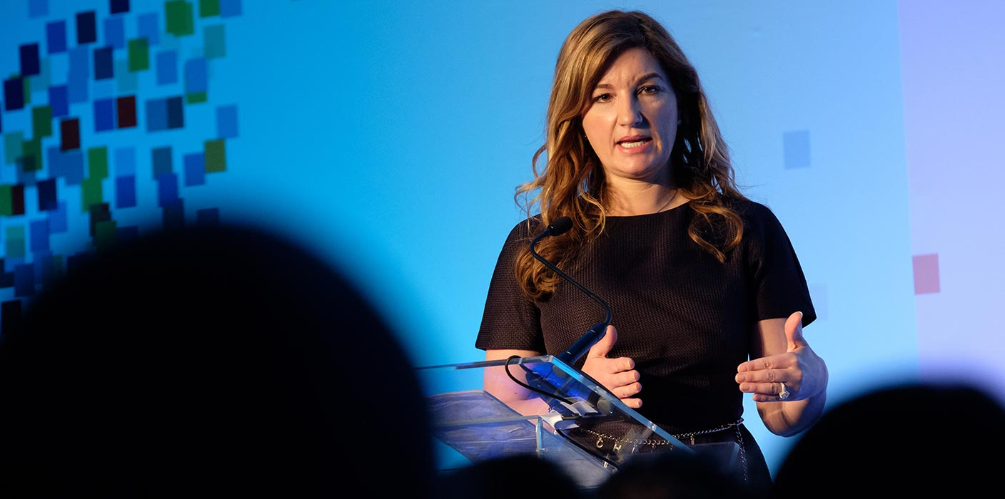 Karren Brady speaking on stage at an event.