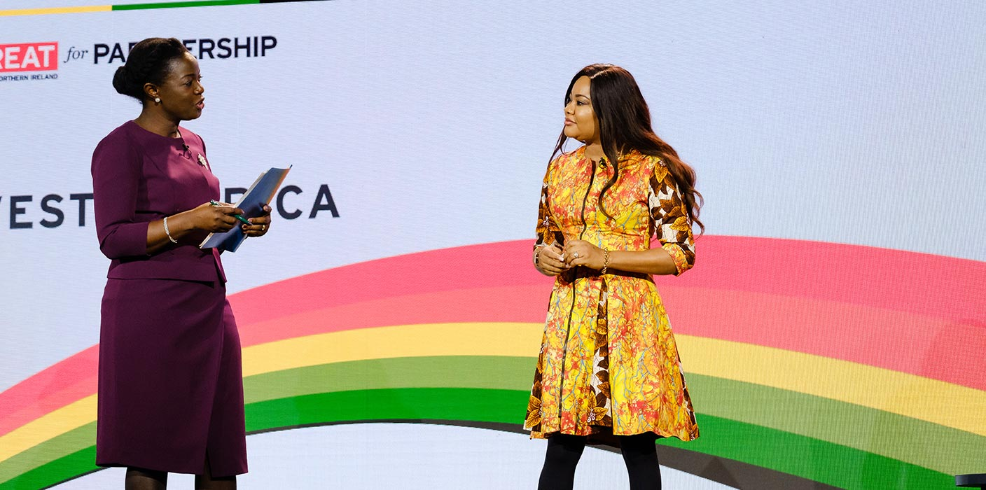 Two female speakers having a discussion on stage at the UK Africa Investment Summit 2020.