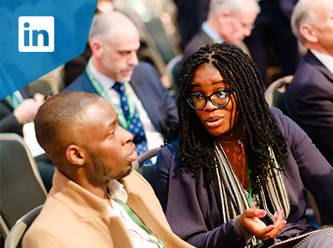 Female delegate talking to a male delegate at the UK Government Africa Investment Summit 2020